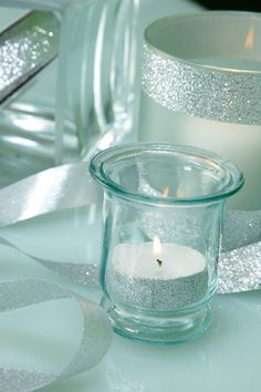 Use double-sided tape to adhere silver glitter ribbon to metal or glass for an instantly glam look! #DIY