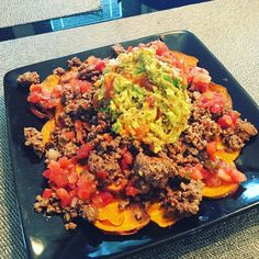 Sweet potato nachos for lunch today! I used a mandolin to slice my sweet potato thin and then tossed the slices in avocado oil Himalayan pink salt and pepper before throwing them in the oven for 20 minutes at 425'. Topped with homemade taco seasoned ground beef guac and fresh pico  #paleo #paleofood #whole30 #cleaneating #grainfree #dairyfree #postworkout #carbcycling #weightloss #weightlossjourney #nachos #guac #homemade #grassfed by fit__for__good