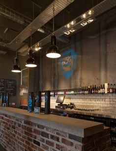 Branding + industrial features + brick bar