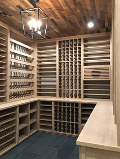 Tuscan style wine room White oak wine racks with barrel stave ceiling, ducted climate control, led lighting and glass door Under Stairs Wine Cellar, Wine Cellar Basement, Glass Wine Cellar, Home Wine Cellars, Wine Rack Design, Wine Cellar Design, Oak Wine Rack, White Wine Rack, Wine Rack Inspiration