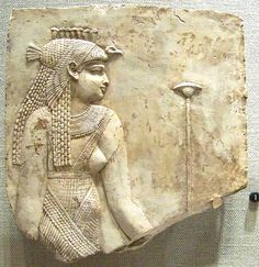 An Egyptian Queen with a Vulture Headdress at Walters Art Museum. Ptolemaic Period, 304-30 B.C. Limestone. The queen wears the vulture headdress topped with seven protective uraeus serpents.