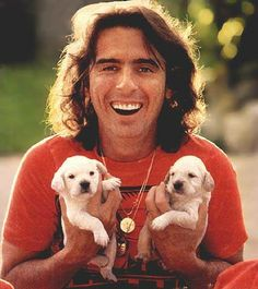 Alice Cooper with puppies...there are just no words!