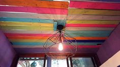 To give your living room a cool and pleasant effect in the summer burning season, then choosing with this pleasant wood pallet creation is superb idea for you. This creation has arranged all the wood pallet planks in one pile form and transform it into the roof ceiling. To make it look catchier, different color shades have been used as the paint color in the planks.