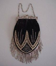 Early Victorian French black velvet purse with cut steel beads