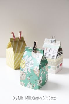 Tutorial | DIY Mini Milk Carton Gift Boxes  These mini milk carton gift boxes over at Gathering Beauty can be used for all sorts of things. They would make great treat bags for birthday parties, or just as a special way to give some candies or cookies to a friend (chocolate eggs for Easter maybe?). You can learn how to make them from scratch using patterned scrapbook paper, and a scoring board (or just use a bone folder and ruler with your cutting mat).