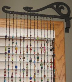 Hippie beaded curtains | This closeup shows the antique brackets, which remindme of 19ca ...