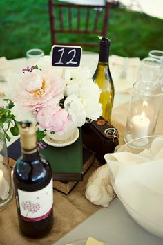 Table decor concept by Tailored Engagements.   Shot by Woodnote Photography. (I helped do these flowers) :)