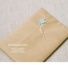 Make a washi tape flag using a cocktail stick and attach it to the parcel. If you use a permanent pen you could write the recipients name on the flag. Simple but quirky!