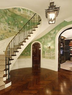 Green de Gournay walls, arched, lacquered door and entrance to library, curved staircase, herringbone wood floors, pagoda lantern