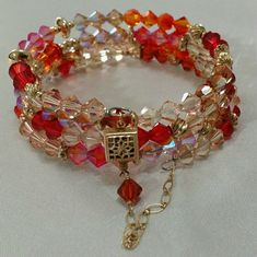 Shop Women's Handmade by me Red Tan size OS Bracelets at a discounted price at Poshmark. Description: Swarovski crystals in hues of tropical flowers - reds, soft pinks, blush, peach, corals. These contrast nicely with the 14K gold filled beads and security clasp. Memory wire is stainless steel.. Sold by karenmi. Fast delivery, full service customer support.