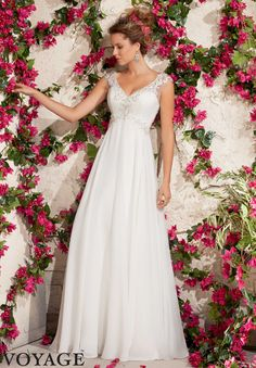 Wedding Gowns By Voyage featuring Embroidered Appliques on Delicate Chiffon with Crystal Beading Available in White/Silver, Ivory/Silver