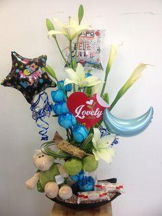 Arreglo especial con flores,globos,y chocolates.