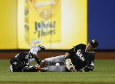 Collision course - Shortstop Adeiny Hechavarria (3) and left fielder Christian Yelich (21 of the Miami Marlins both dive but can't make a catch on a ball hit by Daniel Murphy (28) of the New York Mets for an RBI double during the ninth inning on May 29, 2015 at Citi Field in the Flushing neighborhood of the Queens borough of New York City. The Marlins defeated the Mets 4-3. -  Rich Schultz Getty Images