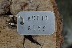 Why find your keys, when they can find you!! Other suggestions include Accio Cat, Accio beer, Accio Tardis and Accio Ferrari.  Order one of these or