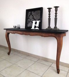 Cut an old table apart to create an awesome console table