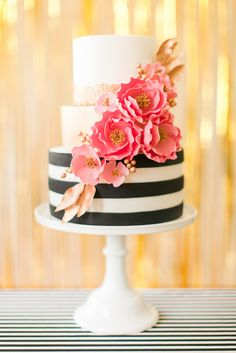 Black & white stripe and pink flower cake.  Love the pink and gold on here…
