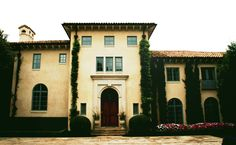 Front facade of an Italian-style villa, designed by Dallas Architect, Steve Chambers, which was based on the concept of a home built on this same property in the 1920s, which the owner loved, but was unable to save. The design combines both Spanish and Italian details and proportions.
