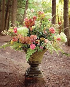 These are nice! An antique urn greeted guests with hydrangeas, zinnias, and dahlias grown by friends and family. ""