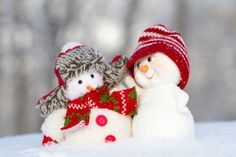 two small cheerful snowman