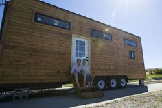 "Robert and Samantha Garlow's Tiny House | Samantha and her husband Robert, 29, started building their tiny home around Thanksgiving 2014. The 8-by-24-foot trailer that serves as the base makes the footprint of their living space just less than 200 square feet. They affectionately named their home SHED; partially because of its size and also because the project is about ""shedding the superfluous."""""