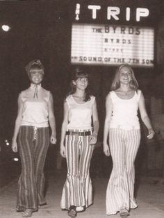 '60s girls walking on the Sunset Strip by The Trip club. Great hip hugger bell bottoms!