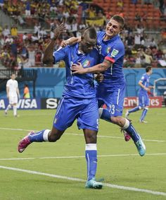 Italy's Mario Balotelli (9) celebrates with Italy's Marco Verratti (23) after Balotelli scored his side's second goal during the group D Wor...