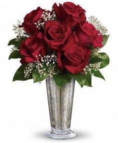 Teleflora's Kiss of the Rose:  Six ravishing red roses mixed with gypsophila and greens are arranged in a Mercury Glass Antique vase. * Inspiration for reception flowers.