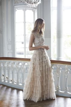 Needle & Thread's New Wedding Dresses Are Something Out of a Fairytale: The Pearlescent gown is equally dreamy and uniquely breathtaking. Fully embellished in hand-sewn silver-cut beads, the semi-illusion bodice features a Victorian high neckline, with the rest of the silhouette covered in soft tulle frills.