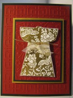 gold embossed kimono on an embossed red card with layers of black + gold...captures the essence of traditional Japan...