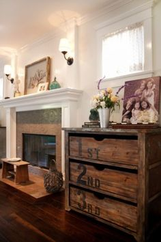 old dresser - re-purposed - great for toys in living room - on side of fireplace opposite tv (with pallet/crate shelves above?)