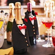 "Champagne-Bottle Tuxedo:   Freezer paper   9-x-11-1/2"" rectangle black felt   Glue gun & hotmelt adhesive   Tiny red silk flower   3 gold brads   3 3/4-inch square of white felt   4"" ea of 1-1/2"" wide red wired ribbon & 1/4"" wide red ribbon"