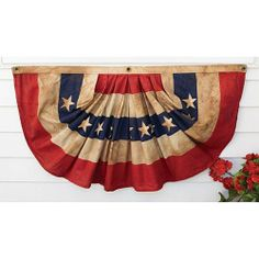 """Proudly made in the USA of 100% antiqued cotton, this Mini Fan Flag is durable enough for years of use. Display in your garden, on your porch, or in your home. This old-fashioned bunting will help patriotic spirit ring out any time of the year. USA. 32""""W x 18""""L   $29.95"""