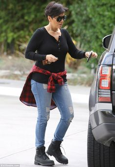 Is Kris Jenner turning into a Kim Kardashian clone? The momager dressed just like her daughter in ripped jeans and a plaid shirt around her waist as she did some holiday shopping on Tuesday