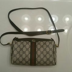Vintage Gucci Purse This authentic vintage Gucci from the 1980s is in poor condition. The strap has come apart and it has a hole on the side (see pictures), but it is a great fixer upper for a little fashionable one. The price is firm. Gucci Bags Crossbody Bags