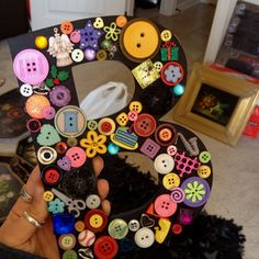 Initial letters made out of random Buttons that I found! All you need is a wooden letter, paint, buttons and hot glue! :)