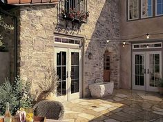 Tuscan stone patio with wrought iron detailing and rustic outdoor lights Eldorado Stone, Outdoor Retreat, Outdoor Spaces, Outdoor Living, Stone Cladding Exterior, Rustic Outdoor, Outdoor Decor, Iron Balcony, Stone Houses