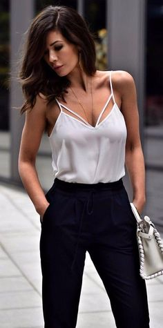 Pretty white satin top with black pants.