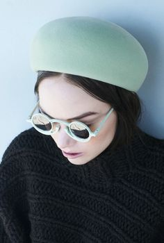 too bad this model looks miserable... i love the mint green hat and shades as well as the sweater