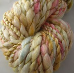 FIRST LOVE - Merino/Bamboo Handspun. Gold, rose, hints of icy blue.