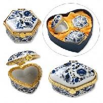 Gift box3-pieceporcelain with acrylicset, gold-colored hinge, blue and gold, with butterfly designwith domed lids, light-duty hinges and detailed packaged in lined heart-shaped gift box.  Approximate box sizes are 2-1/2 x 1-1/2 inch rectangle...