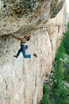 Alli Rainey cuts loose on the super-steep Killer Karma (5.11d) in the Valhalla area. Rock climbing in Ten Sleep, Wyoming.