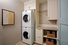 Skinny hidden ironing  board storage next to washer/dryer...like!