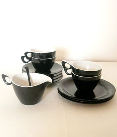 Stylish and fun 1960's 13 piece Melaware black and white tea set – these guys don't need to show off!