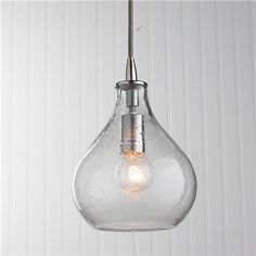 Teardrop Clear Glass Pendant  Seeded glass in a teardrop shape fades from clear to color (or just clear if subtle glisten is what you desire) for an ombre effect with just enough color to pop in your space. Satin Nickel hardware and a silver mesh covered cord.  40 watts. (medium base socket) (9Hx7W) 8 cord 5 canopy  Product SKU: PE12050 CL Price: $199.00