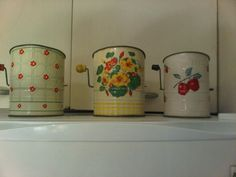 Vintage tin flour sifters. I have bought 2 of the apple ones, one for me and one for Breana
