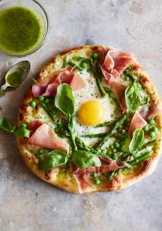 The BEST spring pizza ever! Pea Prosciutto Spring Pizza with an Egg on top from www.whatsgabycooking.com All of the best produce from this season piled onto a pizza!  (@whatsgabycookin)