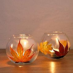 Glue pressed leaves to dollar store containers for these pretty fall leaf votives. Source: Sarah Lipoff