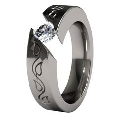 The Samsara Vineleaves titanium engagement ring features a dainty vine leaf carving on either side of the gem.