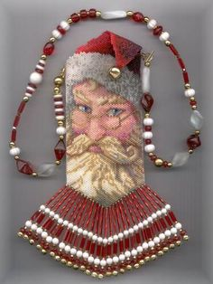 """""""Santa Claus"""" amulet bag Christina Manes 2002   http://www.amuseink.com/santa_lg.jpg (I believe I have this pattern, only 19 colours why have I not done it?)"""