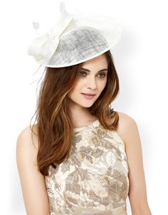 Thelma fascinator, crafted with a curved crin disc with bow and feather decorations. The slim-cut band provides a flattering and comfortable fit.